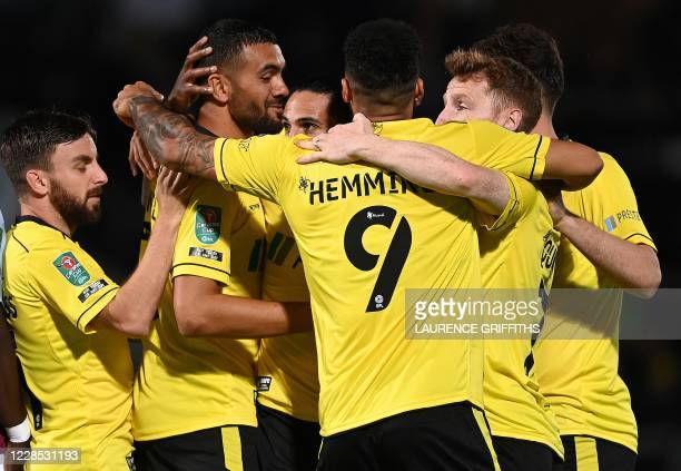 Burton Albion's English defender Colin Daniel is congratulated by teammates after scoring the opening goal during the English League Cup second round...