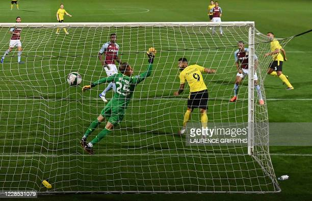 TOPSHOT Burton Albion's English defender Colin Daniel scores the opening goal during the English League Cup second round football match between...