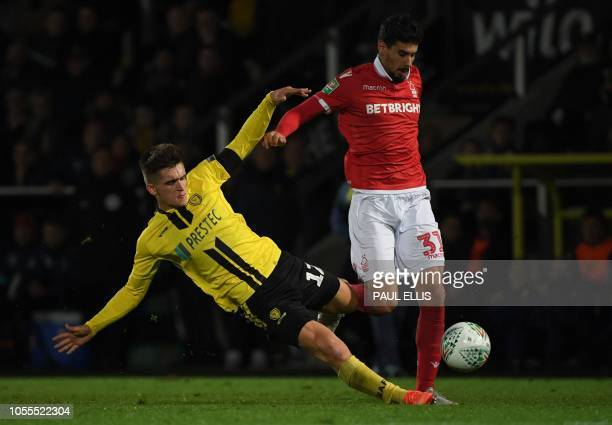 TOPSHOT Burton Albion's English midfielder Ben Fox vies with Nottingham Forest's Portuguese striker Gil Dias during the English League Cup fourth...