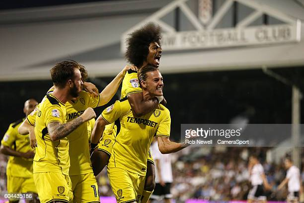 Burton Albion's Jackson Irvine celebrates scoring his sides first goal during the Sky Bet Championship match between Fulham and Burton Albion at the...