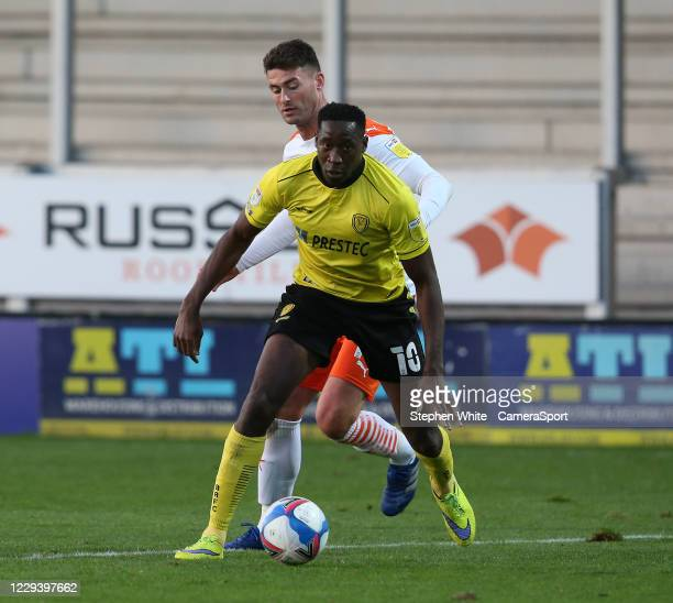 Burton Albion's Lucas Akins shields the ball from Blackpool's Gary Madine during the Sky Bet League One match between Burton Albion and Blackpool at...