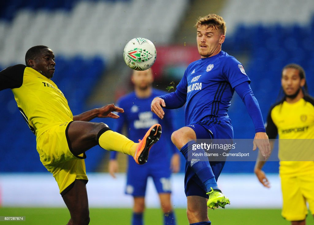 Burton Albion's Lucas Akins vies for possession with Cardiff City's Danny Ward during the Carabao Cup Second Round match between Cardiff City and Burton Albion at Cardiff City Stadium on August 22, 2017 in Cardiff, Wales.
