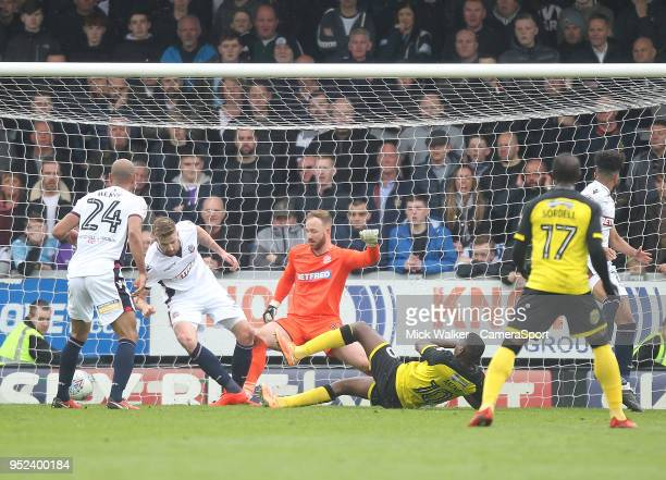 Burton Albion's Lucas Atkins scores his sides second goal beating Bolton Wanderers Ben Alnwick during the Sky Bet Championship match between Burton...