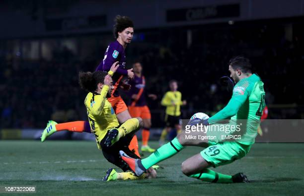 Burton Albion's Marcus Harness has a chance on goal as Manchester City goalkeeper Arijanet Muric slides in Burton Albion v Manchester City Carabao...