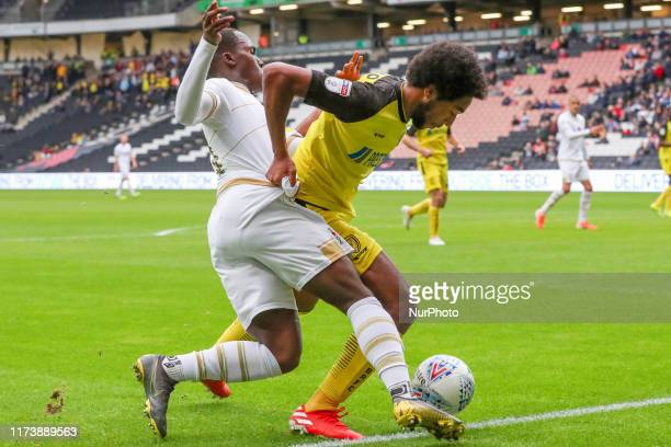Burton Albion's Richard Nartey is challenged by MK Dons Dylan Asonganyi during the second half of the Sky Bet League 1 match between MK Dons and...