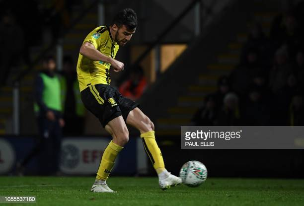 Burton Albion's Scottish midfielder Scott Fraser scores his team's second goal during the English League Cup fourth round football match between...