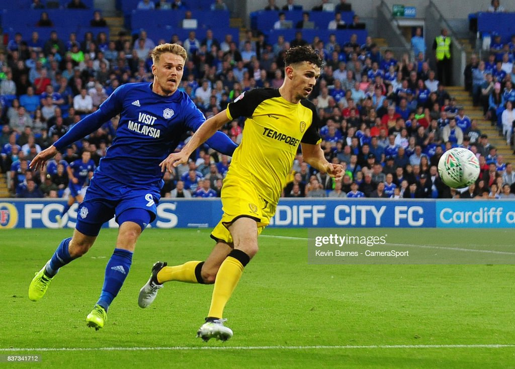 Burton Albion's Tom Flanagan under pressure from Cardiff City's Danny Ward during the Carabao Cup Second Round match between Cardiff City and Burton Albion at Cardiff City Stadium on August 22, 2017 in Cardiff, Wales.