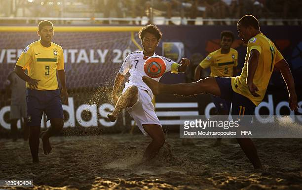 Buru of Brazil and Takeshi Kawaharazuka of Japan battle for the ball during the FIFA Beach Soccer World Cup Group D match between Brazil and Japan at...