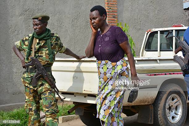Burundi security forces stand guard around the dead bodies killed by unknown gunmen in Bujumbura's Ntahangwa district on October 4 2015 8 dead bodies...