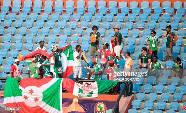 Burundi supporters cheer during the 2019 Africa Cup of Nations Group B football match between Burundi and Guinea at the Al Salam Stadium in the...