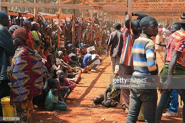 Burundian families who fled their country wait to be registered as refuges at Nyarugusu camp in north west of Tanzania on June 11 2015 Since the...