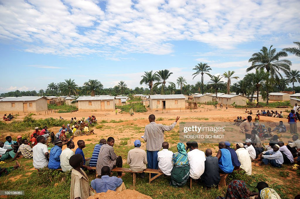 AUSSEILL -- Burundian men and women gather in a field near a cluster of homes donated by the United Nations and known as a 'Peace Village' near the south western Burundian town of Mutambara on May 13, 2010. Some 300 resident families who live in Peace Village are part of a larger group of some 500,000 Burundian refugees who have come back to Burundi since 2002 after having fled to neighboring countries running away form a bloody 13-year civil war.