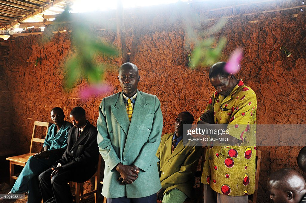 AUSSEILL -- Burundian pastors close their eyes in prayer as they lead a prayer service at a local church at a 'Peace Village' near the south western Burundian town of Mutambara on May 13, 2010
