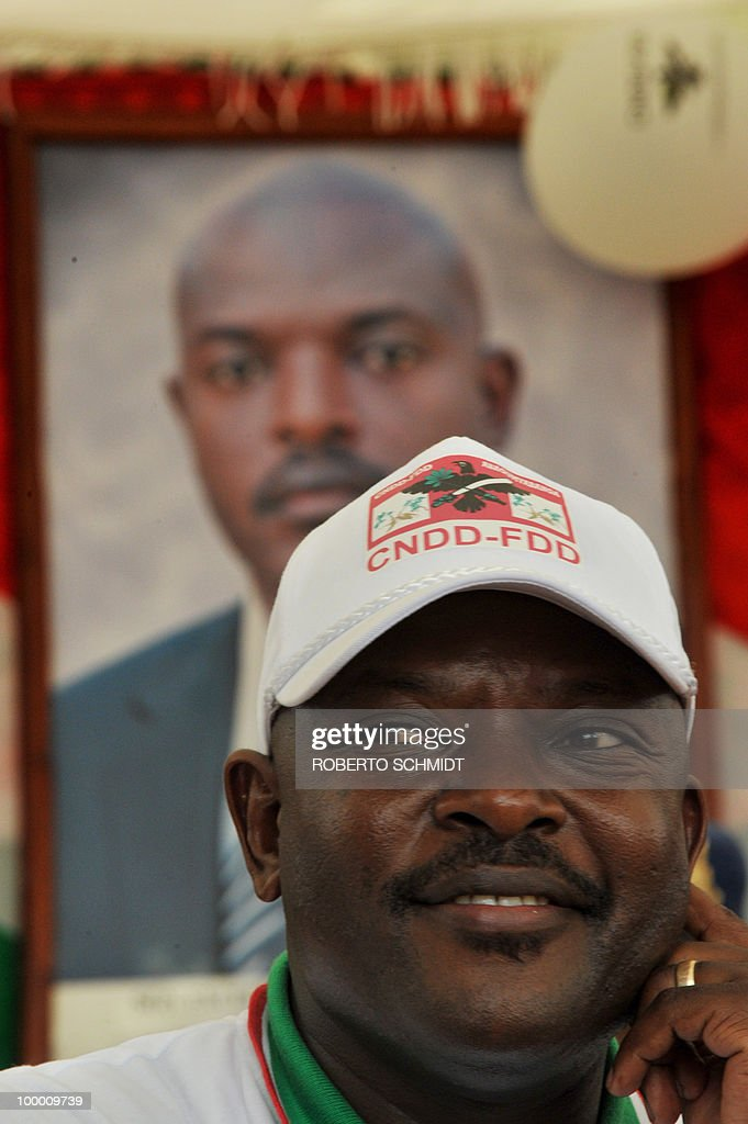 Burundian President Pierre Nkurunziza smiles during an interview with AFP journalists in Rugombo as he rests during a political rally in the north part of Burundi on May 14, 2010. Human Rights Watch has urged Burundian authorities to prevent pre-election violence, as fierce competition between the ruling party and four or five strong opposition movements fuels tension between militants.