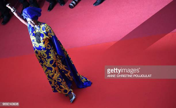 Burundian singer and member of the Feature Film Jury Khadja Nin raises her fist as she arrives on May 16 2018 for the screening of the film 'Burning'...