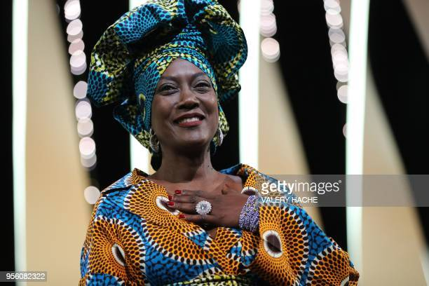 Burundian singer and member of the Feature Film Jury Khadja Nin arrives on stage on May 8, 2018 for the opening ceremony of the 71st edition of the...