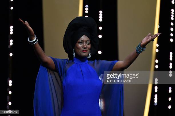 Burundian singer and member of the Feature Film Jury Khadja Nin arrives on stage on May 19, 2018 during the closing ceremony of the 71st edition of...