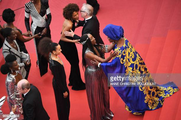 Burundian singer and member of the Feature Film Jury Khadja Nin kisses French actress Nadege BeaussonDiagne as General Delegate of the Cannes Film...
