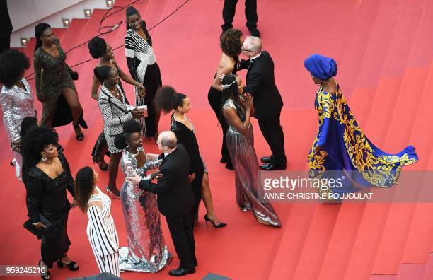 Burundian singer and member of the Feature Film Jury Khadja Nin greets French actress Nadege BeaussonDiagne as General Delegate of the Cannes Film...
