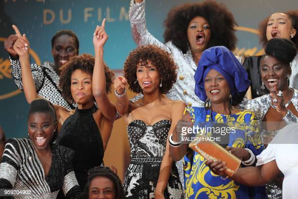 Burundian singer and member of the Feature Film Jury Khadja Nin poses with some of the 16 black women who fight for equality and inclusion of black...