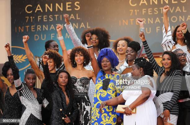 Burundian singer and member of the Feature Film Jury Khadja Nin poses with a group of 16 black women who fight for equality and inclusion of black...