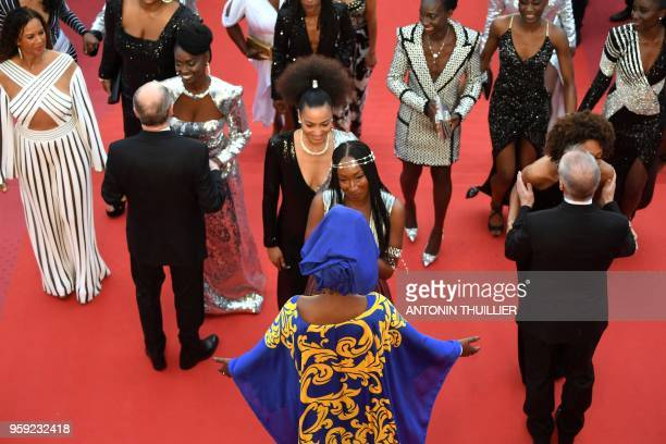 Burundian singer and member of the Feature Film Jury Khadja Nin the President of the Cannes Film Festival Pierre Lescure and the General Delegate of...