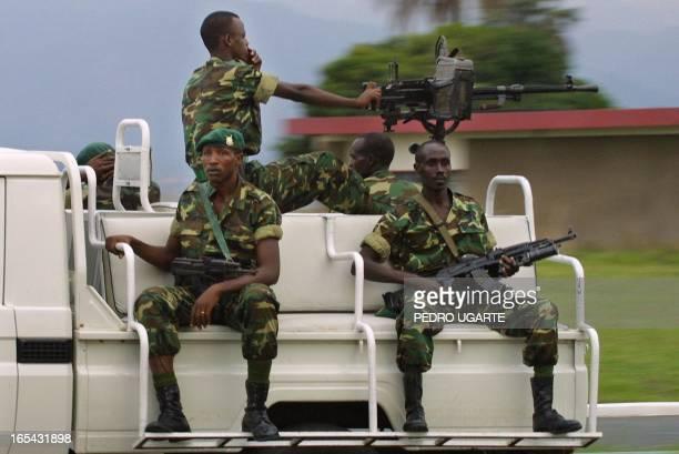 Burundian soldiers escort the motorcade of Malawi's president Bakili Mulizi in Bujumbura Burundi 31 October 2001 A transitional powersharing...