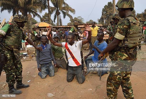 Burundian soldiers from the Africanled International Support Mission to the Central African Republic detain and search antiBalaka militiamen who were...