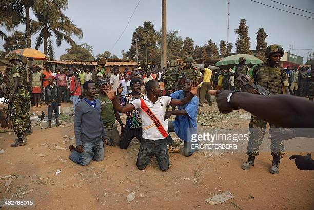 Burundian soldiers from the Africanled International Support Mission to the Central African Republic and French soldiers detain and search antiBalaka...