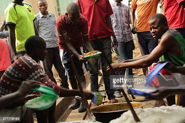Burundian students serve their only meal of the day as they continue to seek refuge near the American Embassy on June 19 2015 in Bujumbura Burundi...