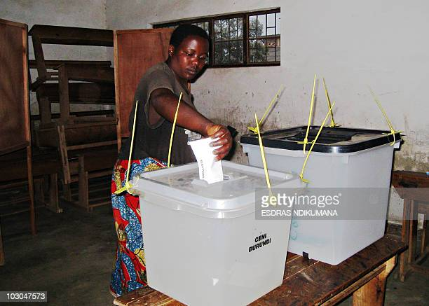 A Burundian voter casts her vote at a polling station in Burundi's capital Bujumbura on July 23 2010 Burundians vote in parliamentary polls the...