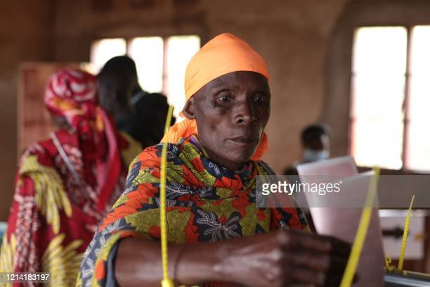 Burundian woman casts her ballot during the presidential and general elections at the Bubu Primary school in Giheta, central Burundi, on May 20, 2020.