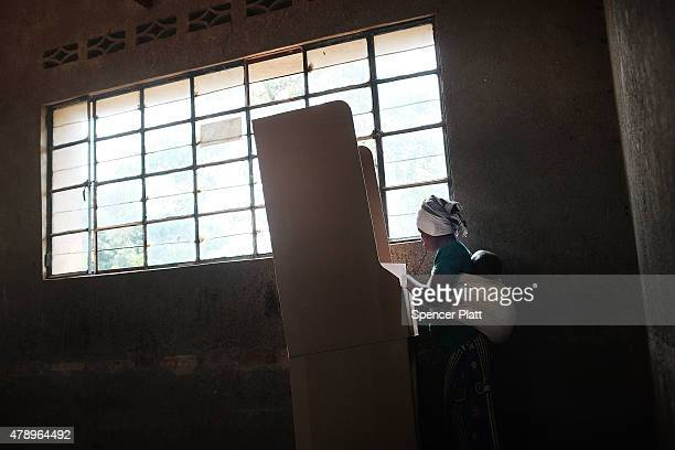Burundian woman votes in a polling station during parliamentary and local elections on June 29, 2015 in Bujumbura, Burundi. The African Union...