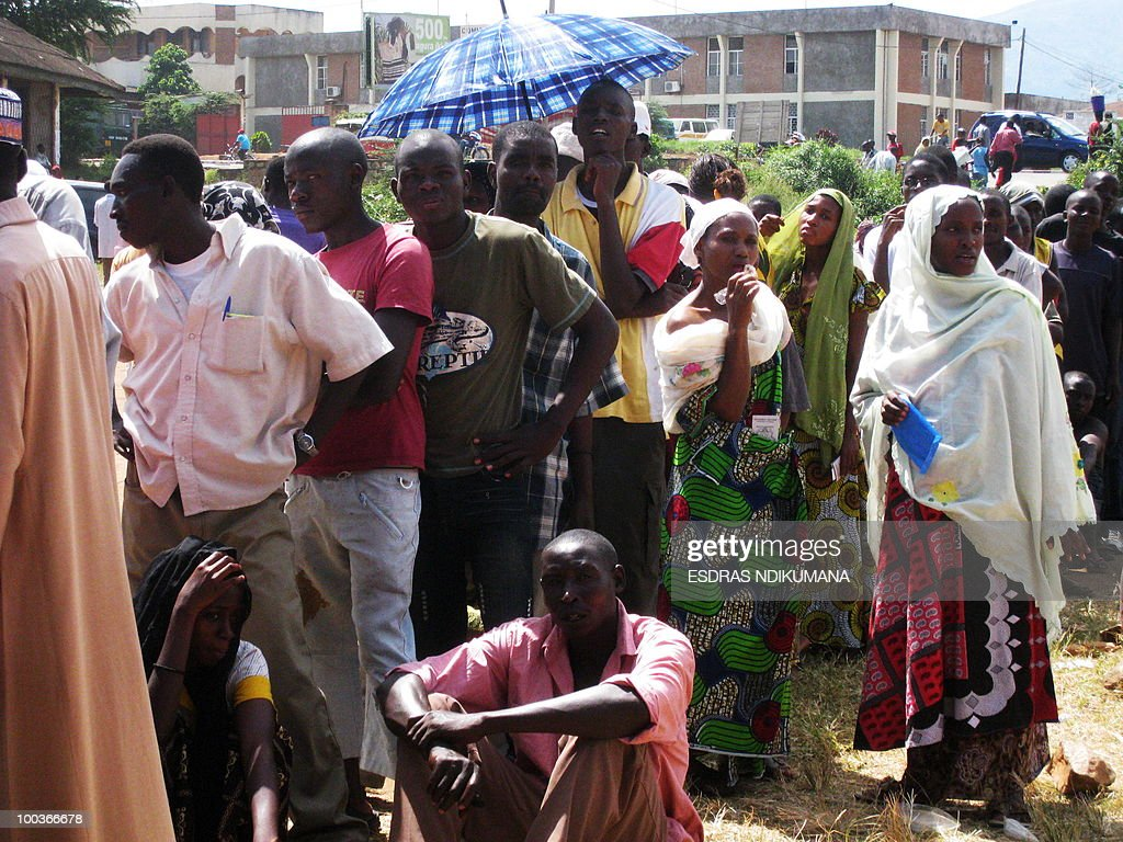 Burundians wait in line to vote on May 24, 2010 at a polling station in the capital Bujumbura. Local polls kicked off on May 24 in Burundi, the first phase of an electoral marathon set to put the small, war-scarred African nation's peace deal and democratic credentials to the test. Polling stations opened at 6:00 am (0400 GMT), with some 3.5 million voters called to pick local councillors in a ballot seen a key test for presidential and legislative elections due in June and July respectively.