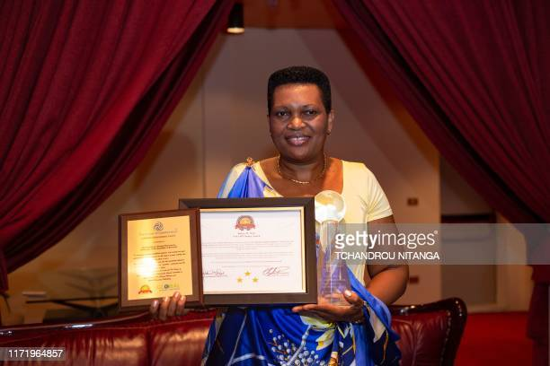Burundi's first lady Denise Bucumi Nkurunziza show awards for being an excellent role model for positive change that she received during high level...