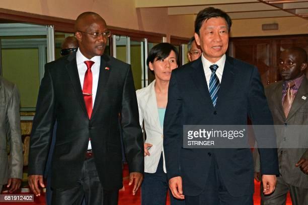 Burundi's first vice-president Gaston Sindimwo meets Chinese vice-president Li Yuanchao at the Bujumbura airport on May 10, 2017 in Bujumbura....