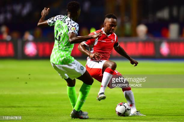 Burundi's forward Saido Berahino is marked by Nigeria's midfielder Wilfred Ndidi during the 2019 Africa Cup of Nations football match between Nigeria...