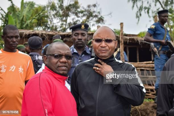 Burundi's minister of public security Alain Guillaume Bunyoni the Governor of Cibitoke Province Joseph Iteriteka visit Ruhagarika village where 26...
