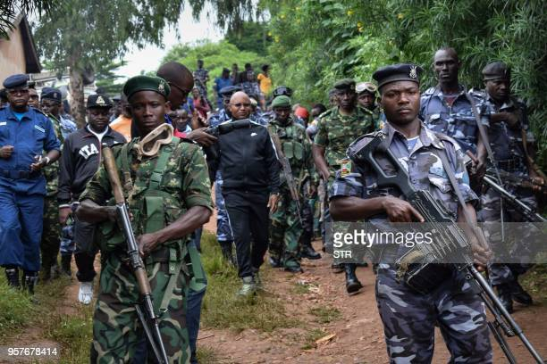 Burundi's minister of public security Alain Guillaume Bunyoni visits with other officials Ruhagarika village where 26 people were killed by the armed...