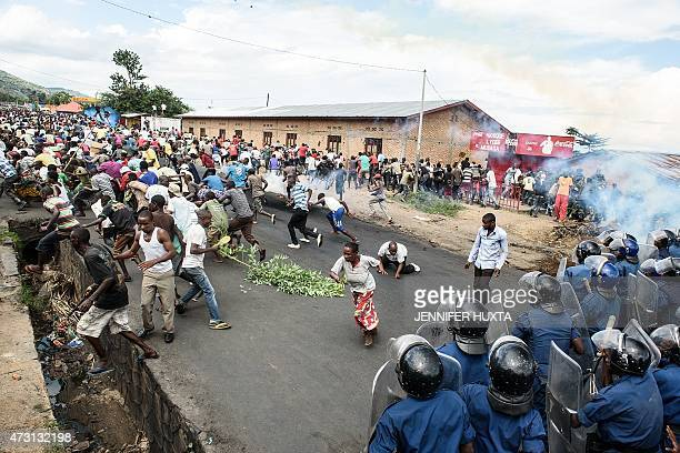 Burundi's policemen and army forces face protestors during a demonstration against incumbent president Pierre Nkurunziza's bid for a 3rd term on 13...