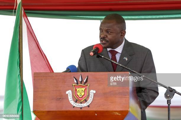 Burundi's President Pierre Nkurunziza addresses the gathering after signing for a new constitution adopted by a referendum in Bugendana Burundi on...