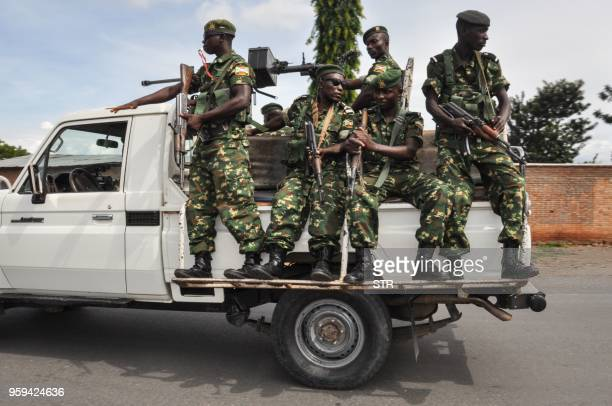 TOPSHOT Burundi's security guards patrol near a polling station for the referendum on a controversial constitutional reform in Bujumbra Burundi on...