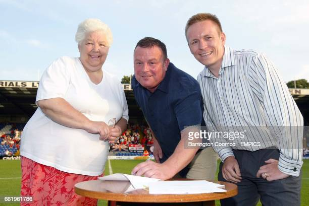 Bury FC Director Margaret Ladkin Director Tony Pritchard and fellow Director Scott Fletcher sign the ground share deal with Bury FC before the game