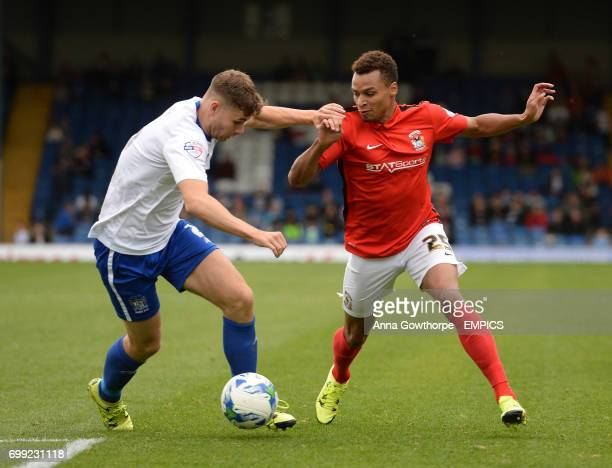 Bury FC's Joe Riley and Coventry City's Jacob Murphy in action