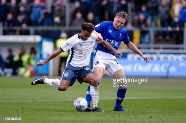 Bury forward Nicky Maynard and Carlisle United defender Peter Grant during the Sky Bet League 2 match between Carlisle United and Bury at Brunton...