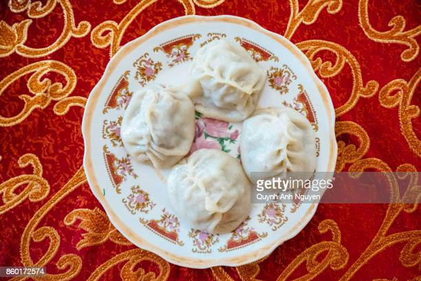 buryatian chinese style steamed meat dumplings (buuz or manti) - russian culture stock pictures, royalty-free photos & images
