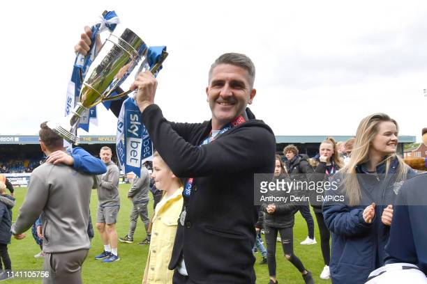 Bury's manager Ryan Lowe carries the trophy during a lap of honour as Bury are promoted to league one Bury v Port Vale Sky Bet League Two Gigg Lane