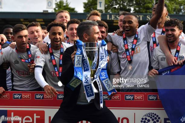 Burys manager Ryan Lowe lifts the trophy during a lap of honour as Bury are promoted Bury v Port Vale Sky Bet League Two Gigg Lane