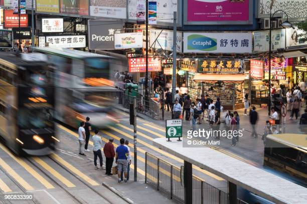 A bus and a tramway, captured rush in the street in the famous shopping district of Causeway Bay in Hong Kong