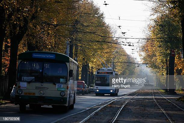 A bus and a trolley bus make their way along the road on October 28 2011 in Kaliningrad Russia Kaliningrad is one of thirteen proposed host cities...
